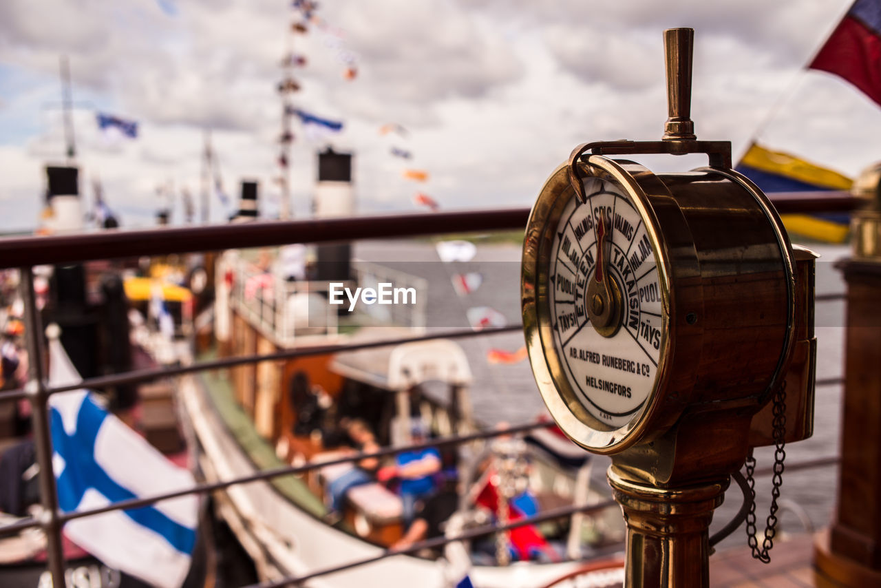 focus on foreground, architecture, built structure, no people, mode of transportation, transportation, time, building exterior, metal, day, clock, nautical vessel, outdoors, close-up, nature, shape, cloud - sky, city, communication, travel, wheel