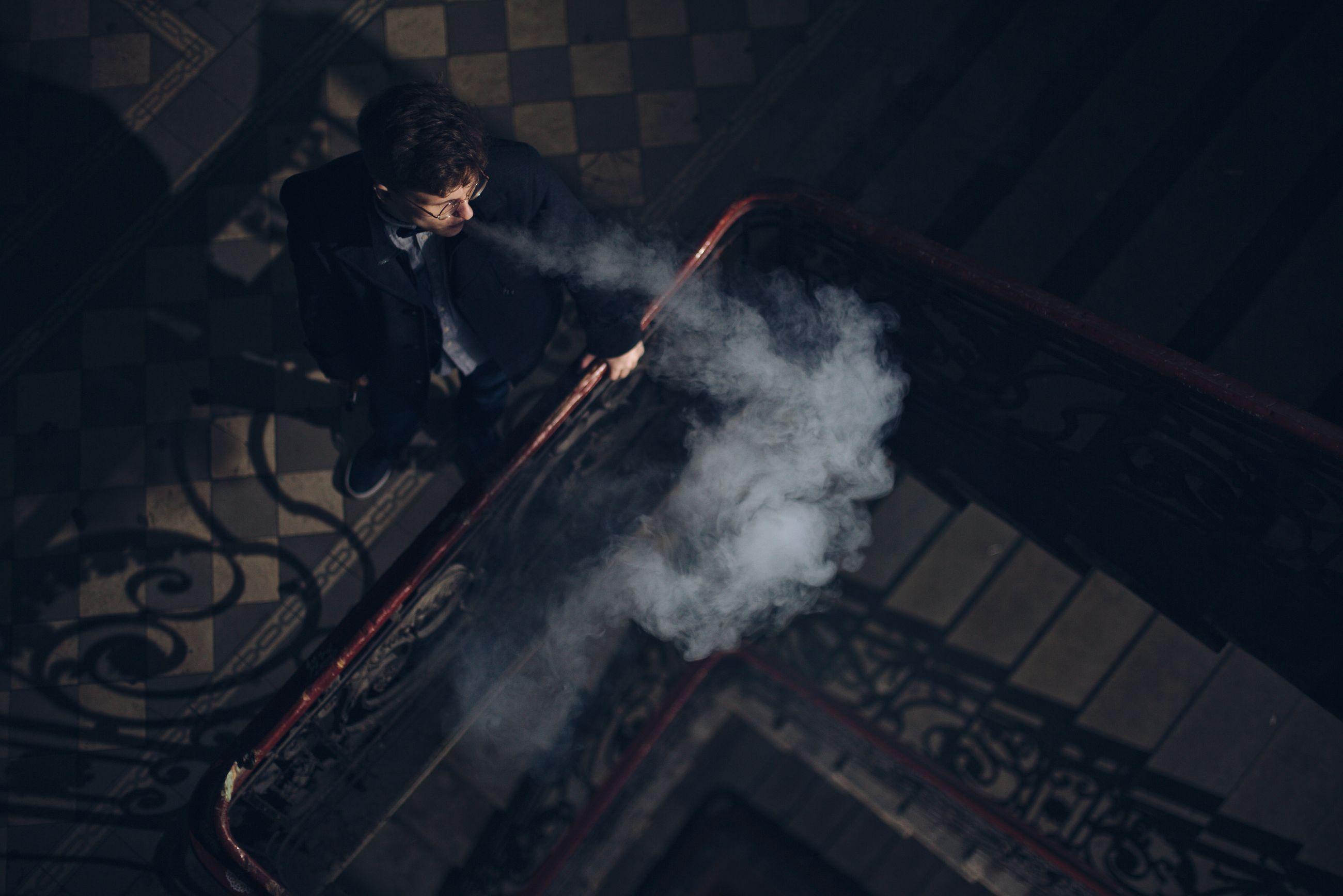 High angle view of man smoking at corridor