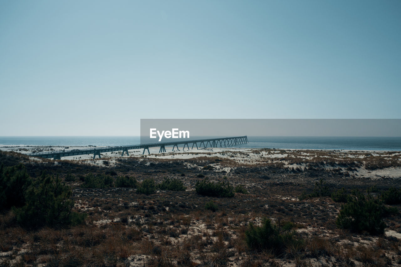 water, sea, sky, horizon over water, scenics - nature, horizon, tranquil scene, nature, land, copy space, bridge, tranquility, beach, clear sky, no people, day, beauty in nature, architecture, built structure, bridge - man made structure, outdoors