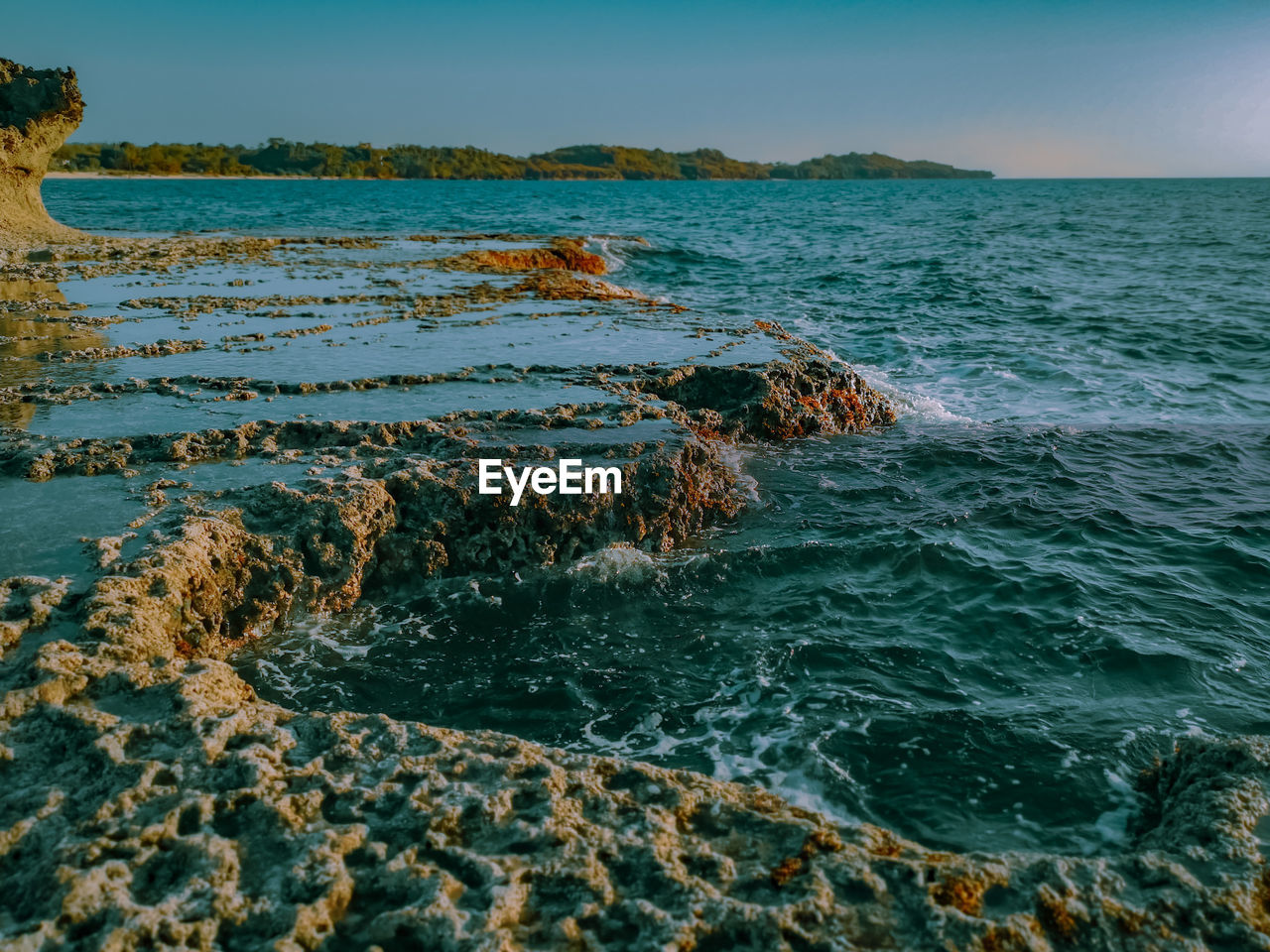 sea, water, beauty in nature, sky, scenics - nature, nature, rock, day, no people, solid, motion, land, rock - object, wave, tranquility, beach, tranquil scene, waterfront, horizon, outdoors, horizon over water, marine