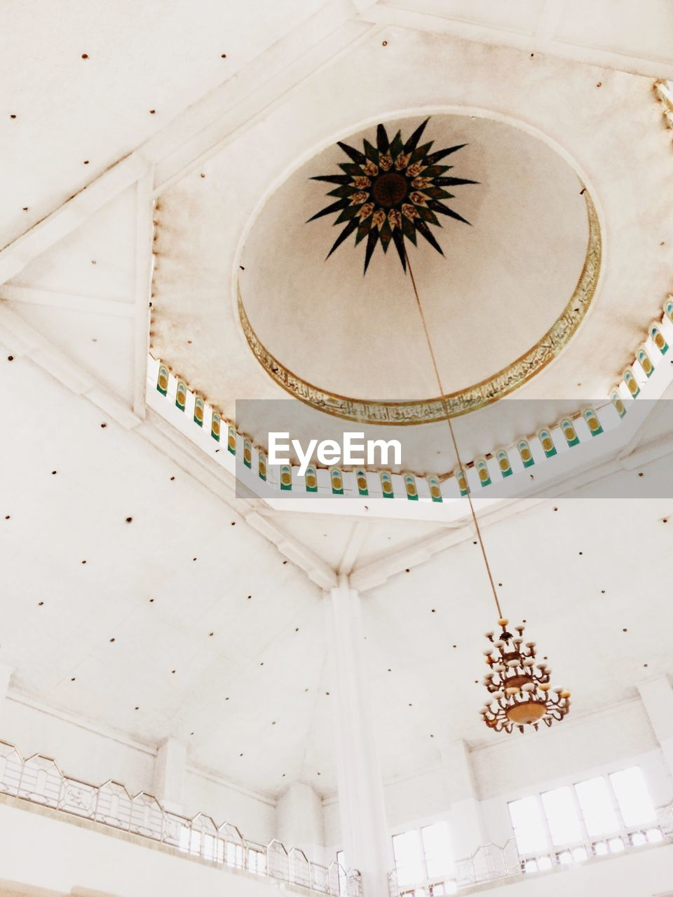 indoors, low angle view, built structure, ceiling, no people, architecture, place of worship, day