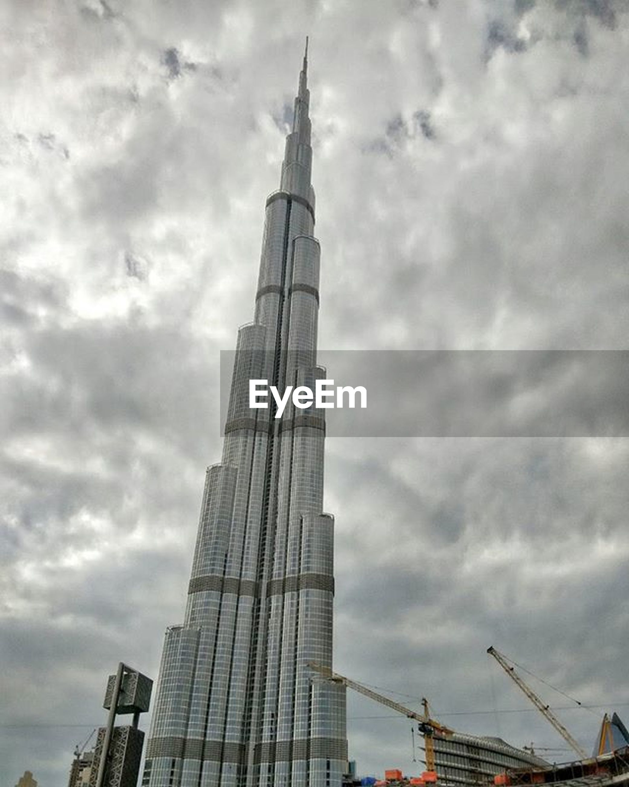 architecture, sky, built structure, building exterior, cloud - sky, low angle view, cloudy, tower, tall - high, cloud, city, weather, overcast, travel destinations, tall, famous place, capital cities, outdoors, day, skyscraper