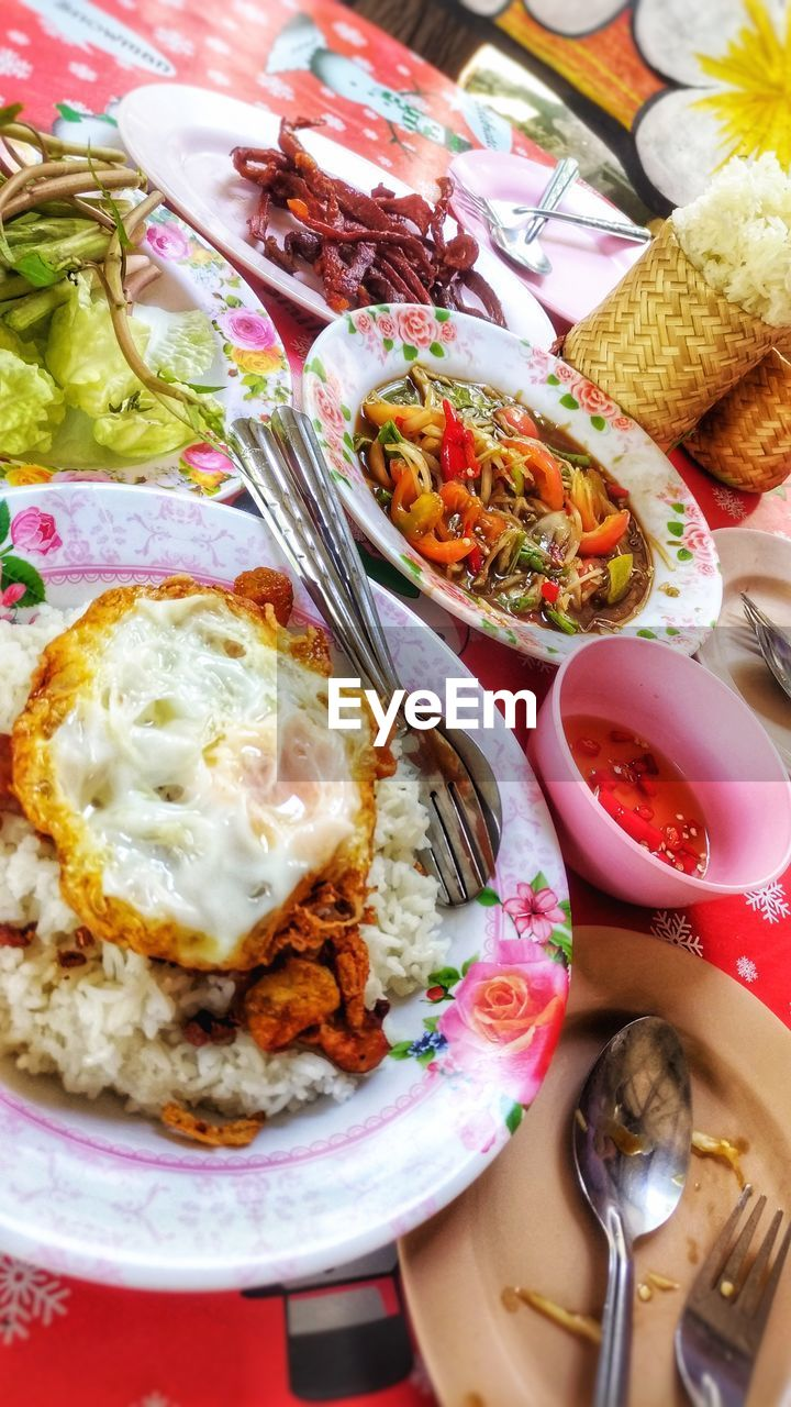 food and drink, food, ready-to-eat, table, freshness, healthy eating, plate, meal, indoors, still life, wellbeing, high angle view, serving size, vegetable, eating utensil, close-up, no people, indulgence, spoon, meat, temptation, garnish, crockery