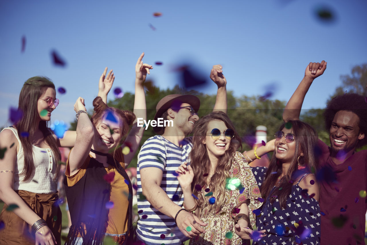 happiness, enjoyment, group of people, smiling, cheerful, young adult, fun, emotion, event, young women, togetherness, friendship, festival, lifestyles, women, celebration, adult, human arm, leisure activity, arms raised, music festival