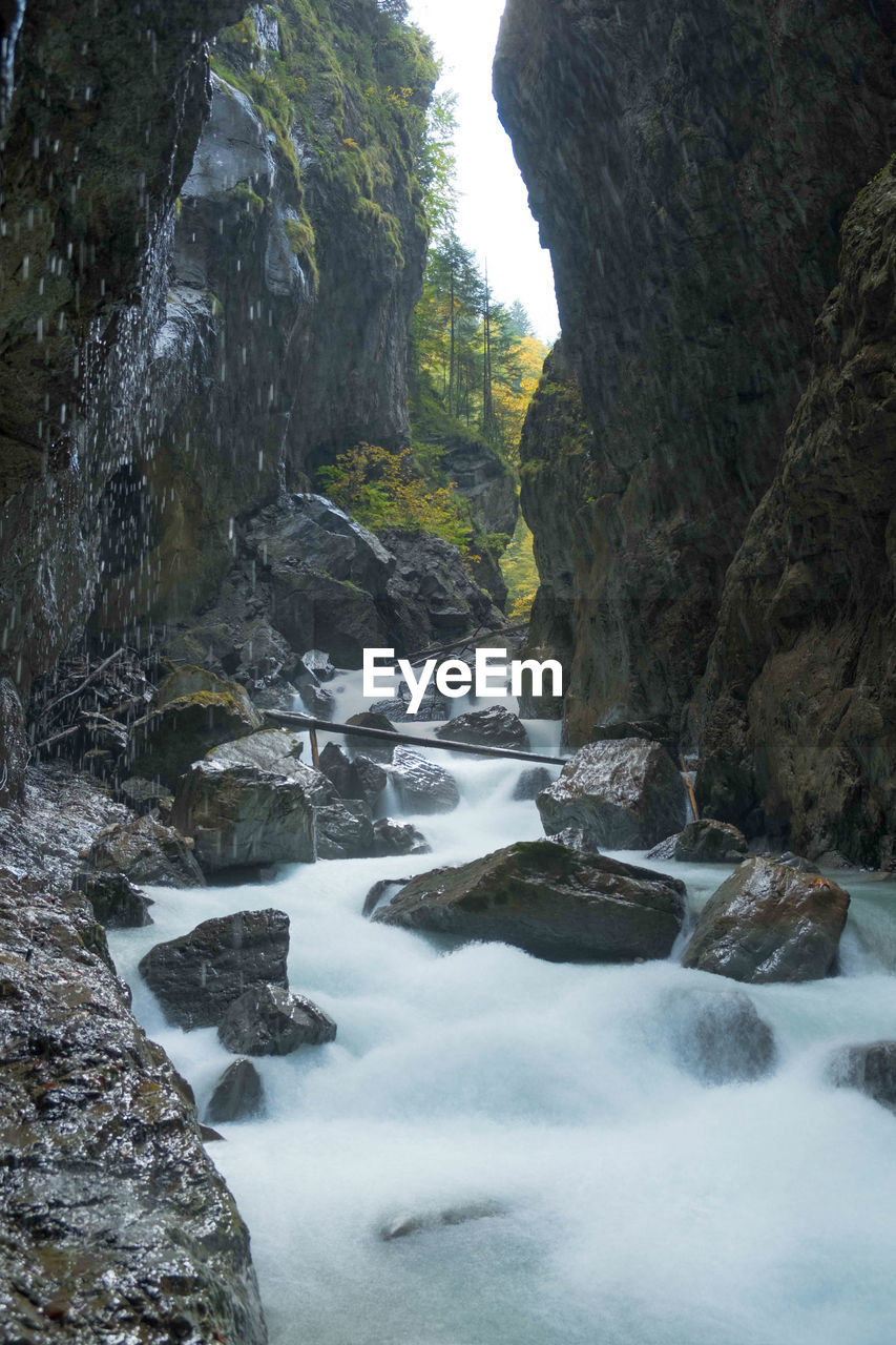 rock - object, rock formation, waterfall, water, nature, scenics, beauty in nature, motion, rock, long exposure, day, tranquil scene, no people, river, tranquility, outdoors, cliff, mountain, sky