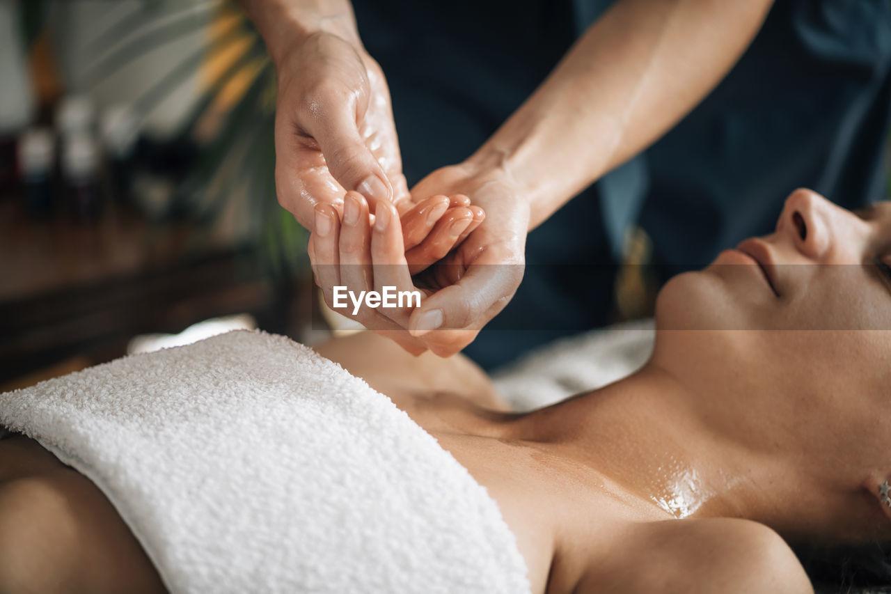 Ayurvedic aromatherapy oil massage. masseuse holding ayurveda oil for body massage