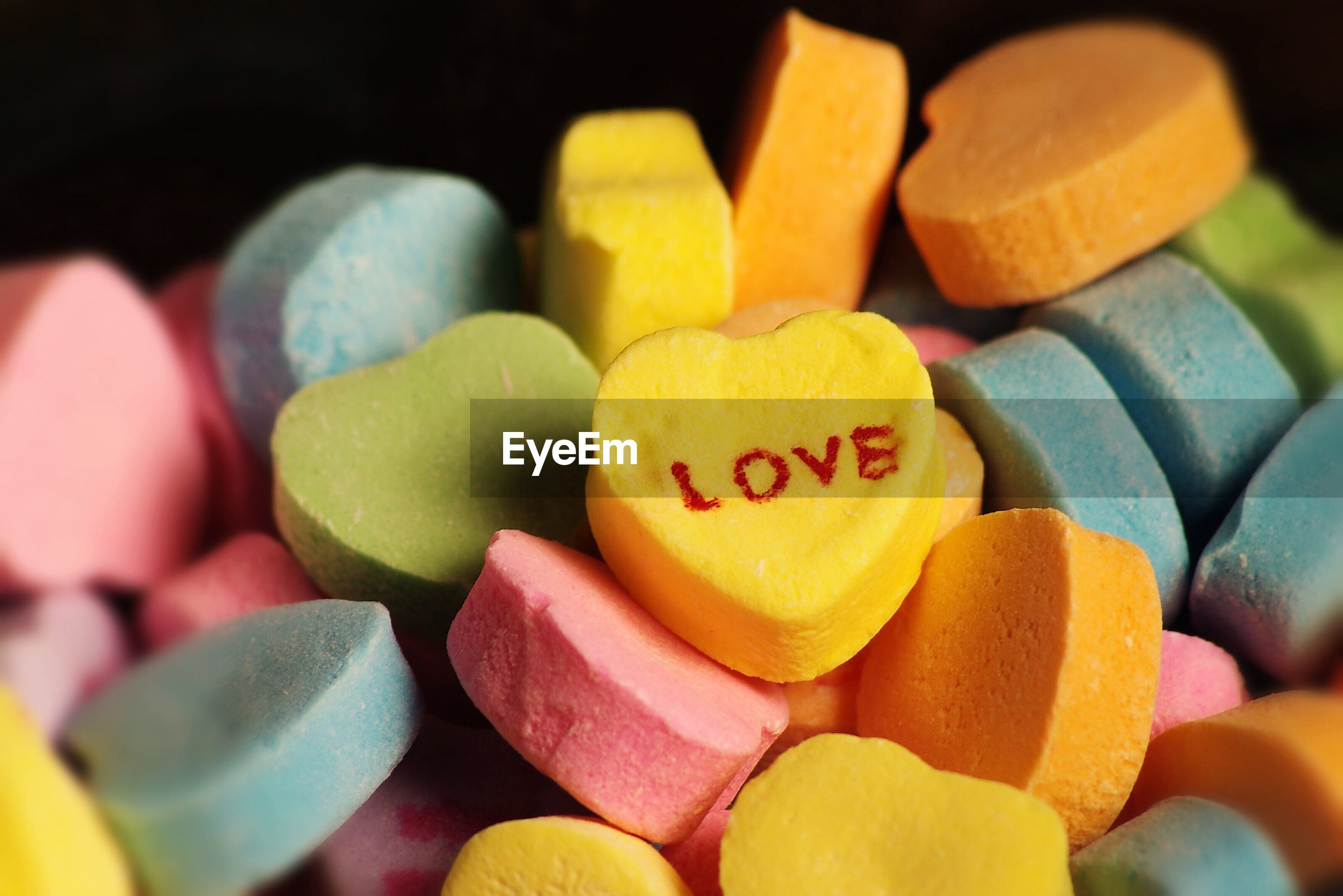 Close-up of multi colored heart shape with text