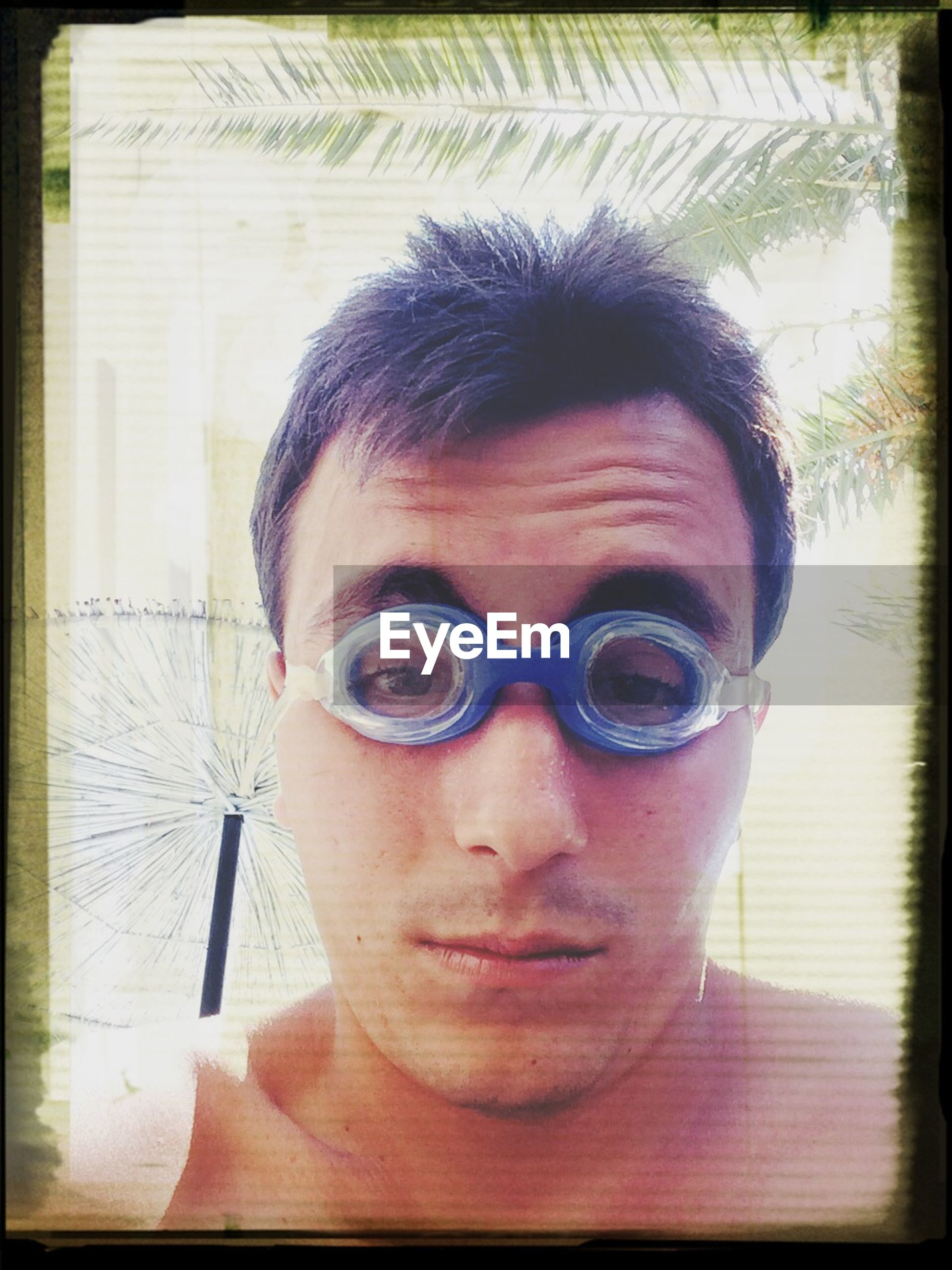 looking at camera, transfer print, portrait, young adult, person, lifestyles, auto post production filter, headshot, front view, young men, leisure activity, indoors, sunglasses, mid adult, mid adult men, casual clothing, head and shoulders