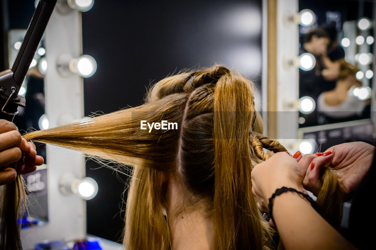 Cropped Image Of Hairdressers With Woman Hair Salon
