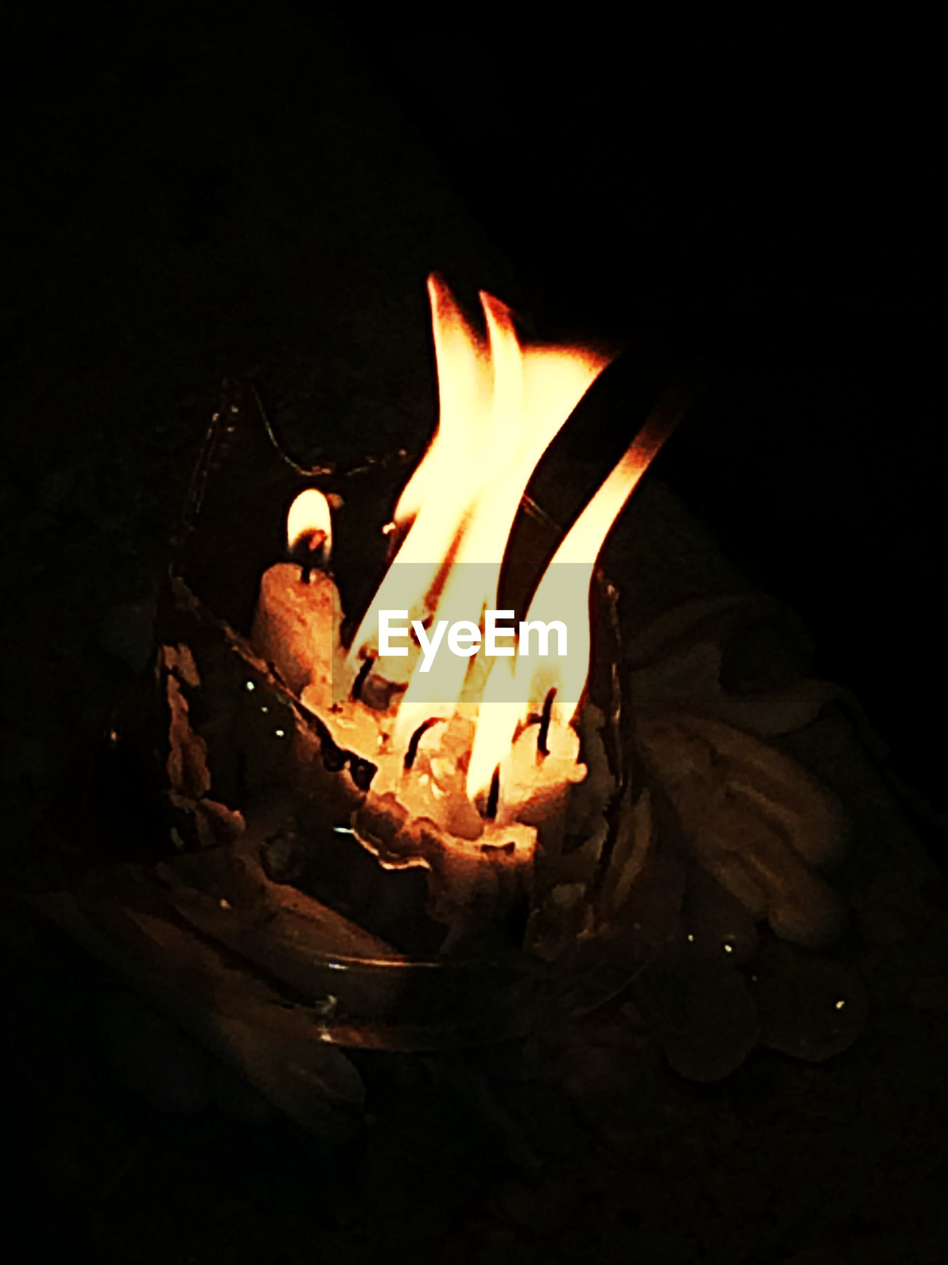 person, burning, black background, flame, indoors, studio shot, fire - natural phenomenon, heat - temperature, close-up, night, holding, part of, dark, cropped, freshness, copy space, unrecognizable person