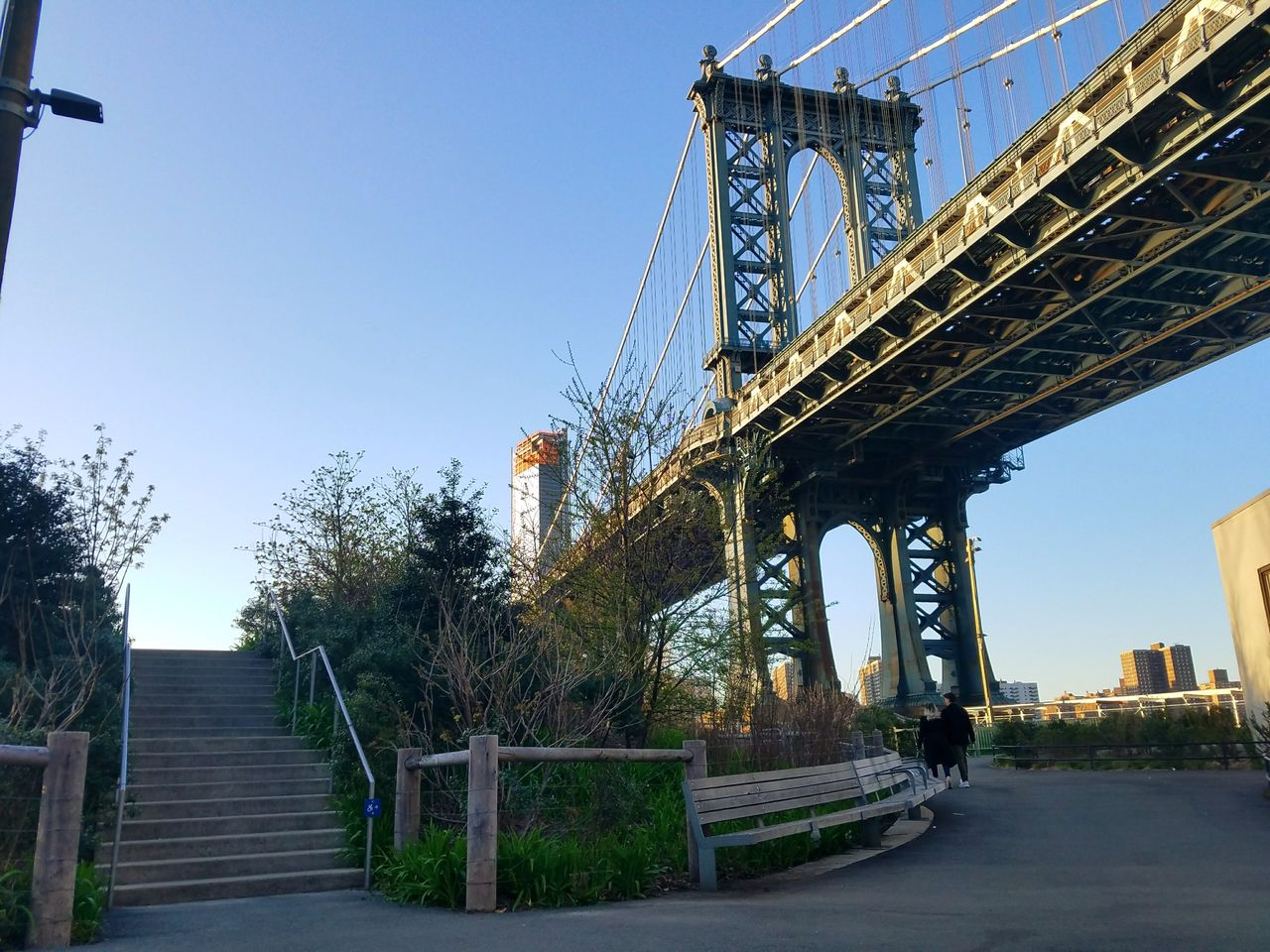sky, architecture, built structure, connection, transportation, clear sky, bridge, tree, nature, plant, bridge - man made structure, low angle view, day, no people, outdoors, direction, city, the way forward, building exterior
