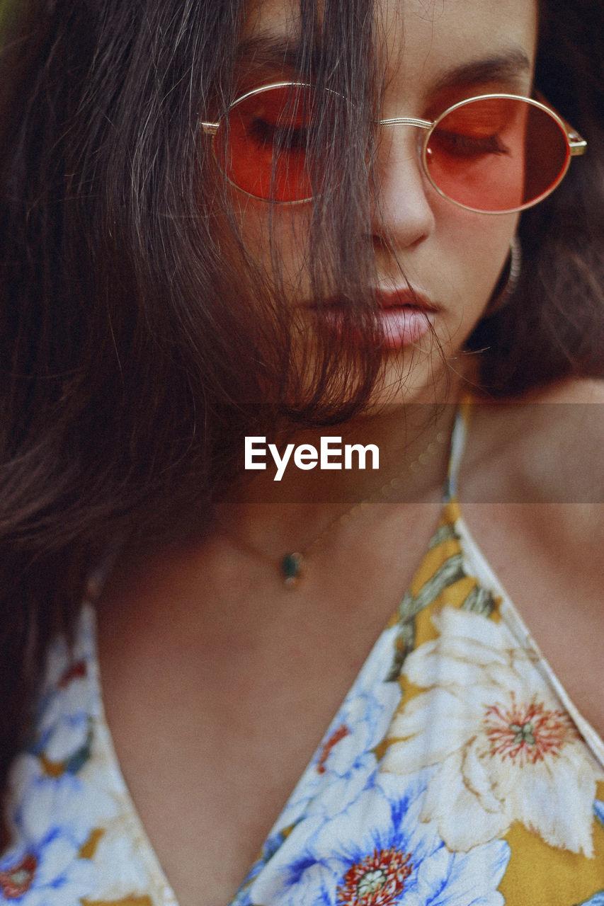 Close-Up Of Teenage Girl Wearing Sunglasses