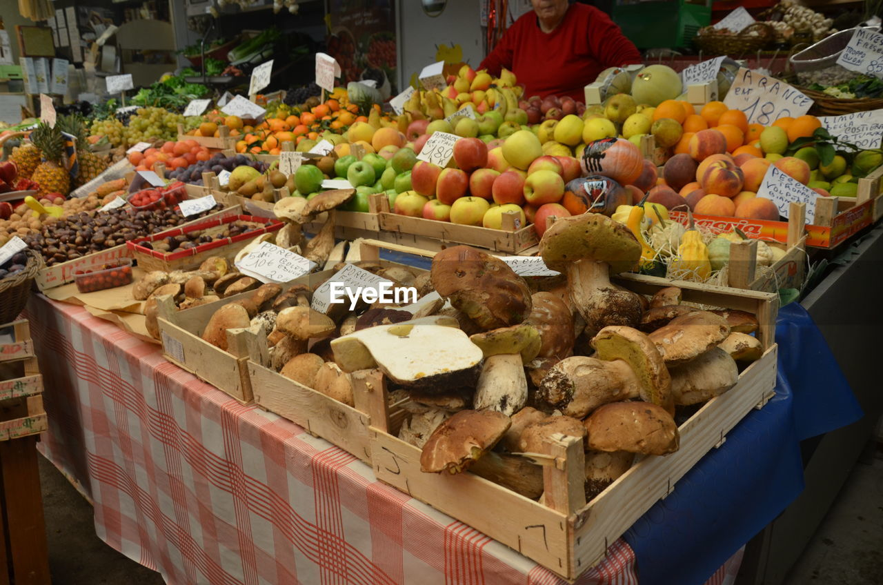 food and drink, food, for sale, variation, market, fruit, freshness, retail, choice, market stall, real people, abundance, arrangement, healthy eating, large group of objects, banana, small business, apple - fruit, outdoors, men, price tag, day, mango, one person