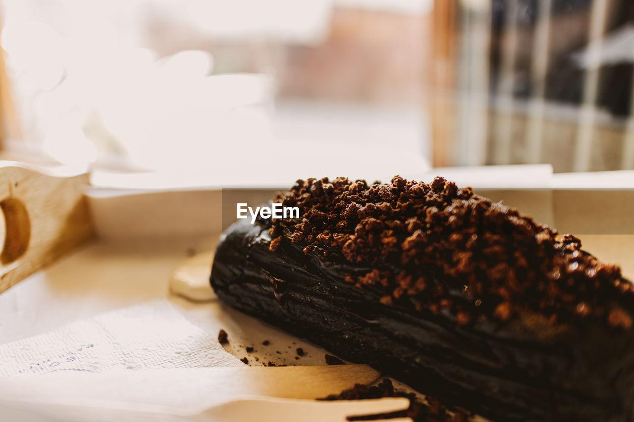 Dark chocolate bread with white creamy custard in a cafe.