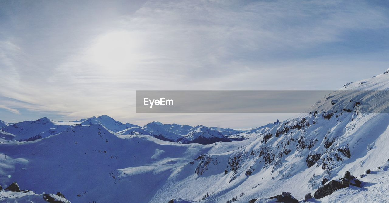 snow, winter, cold temperature, scenics, beauty in nature, nature, mountain, tranquil scene, tranquility, sunlight, weather, outdoors, sky, day, mountain range, snowcapped mountain, no people, landscape