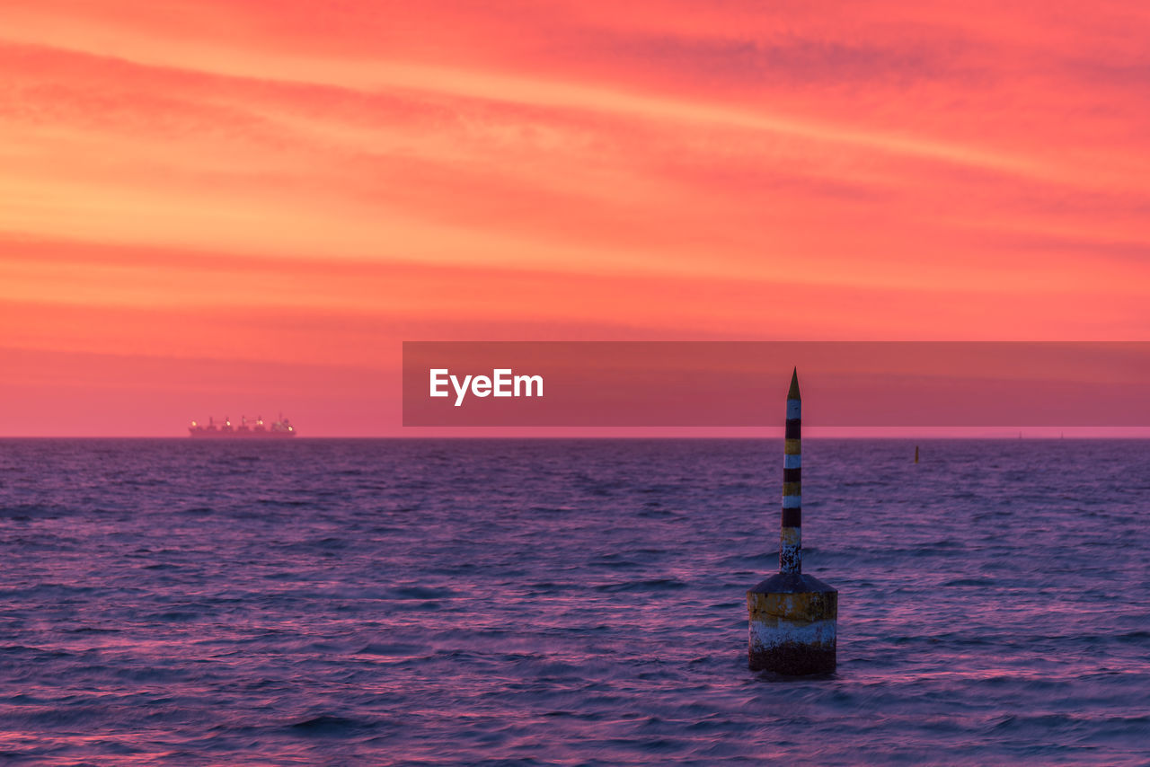 sunset, sea, water, horizon over water, no people, sky, scenics, beauty in nature, nature, tranquil scene, tranquility, outdoors, lighthouse, day