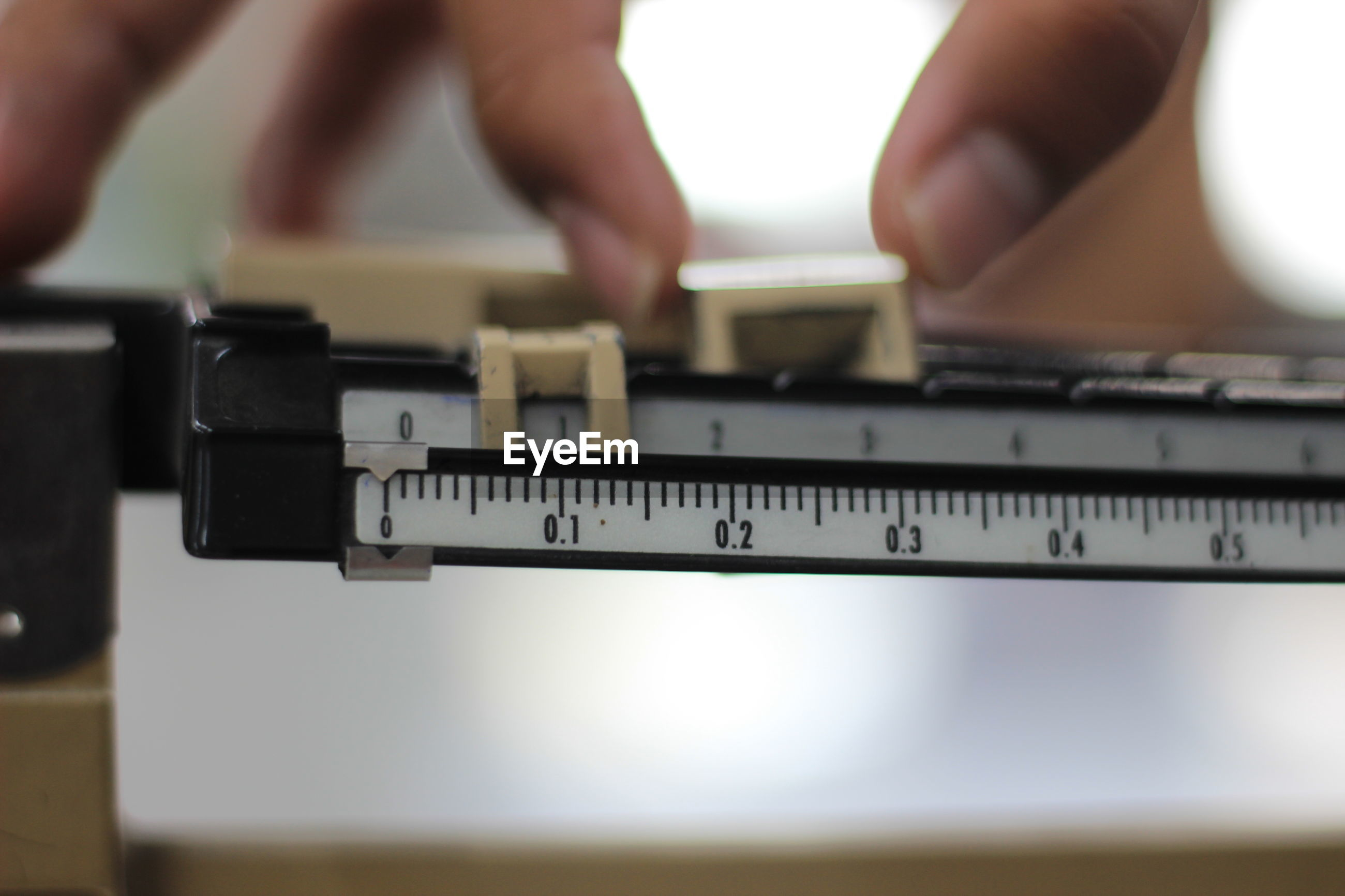 Cropped hand with instrument of measurement