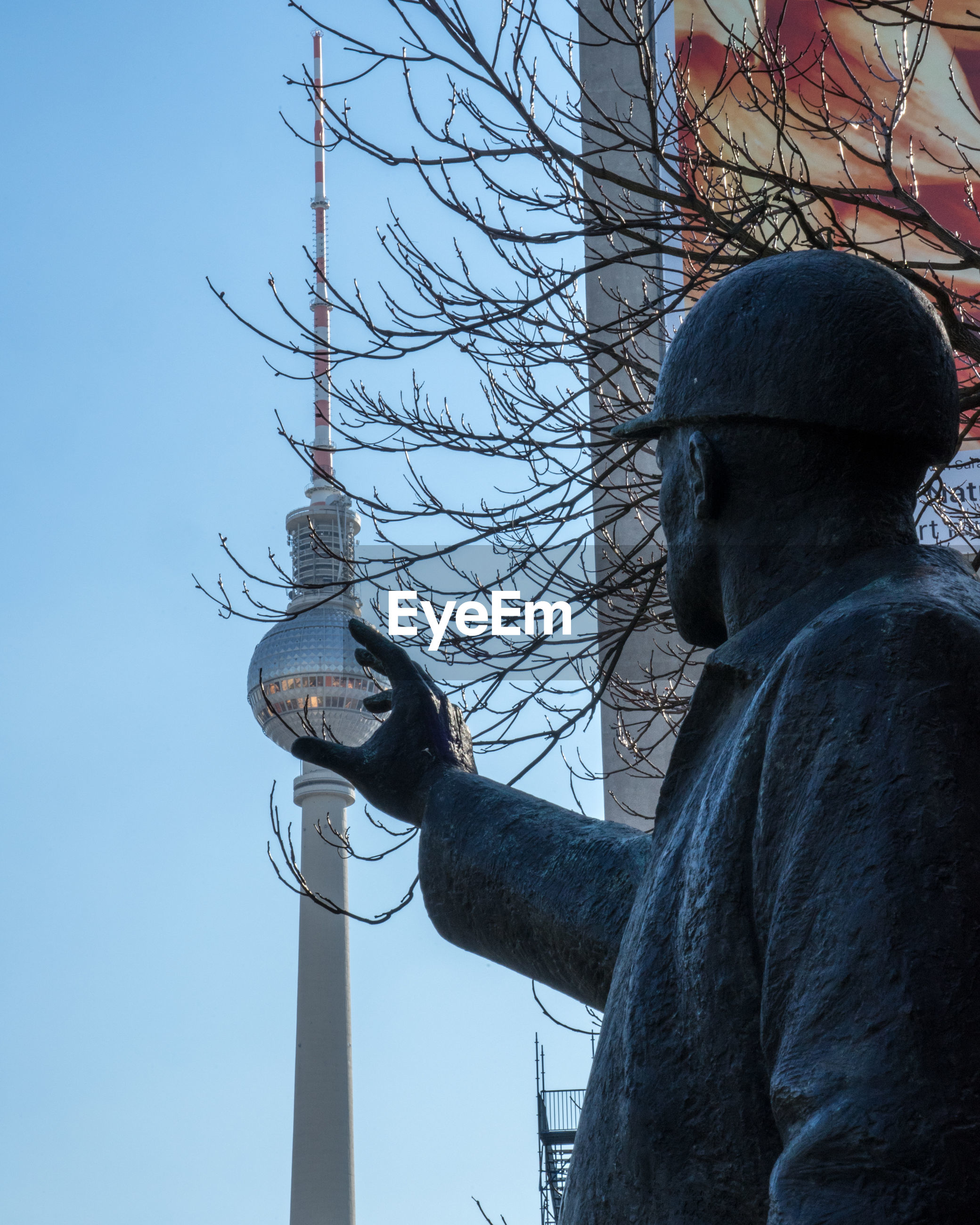 LOW ANGLE VIEW OF STATUE AGAINST THE SKY