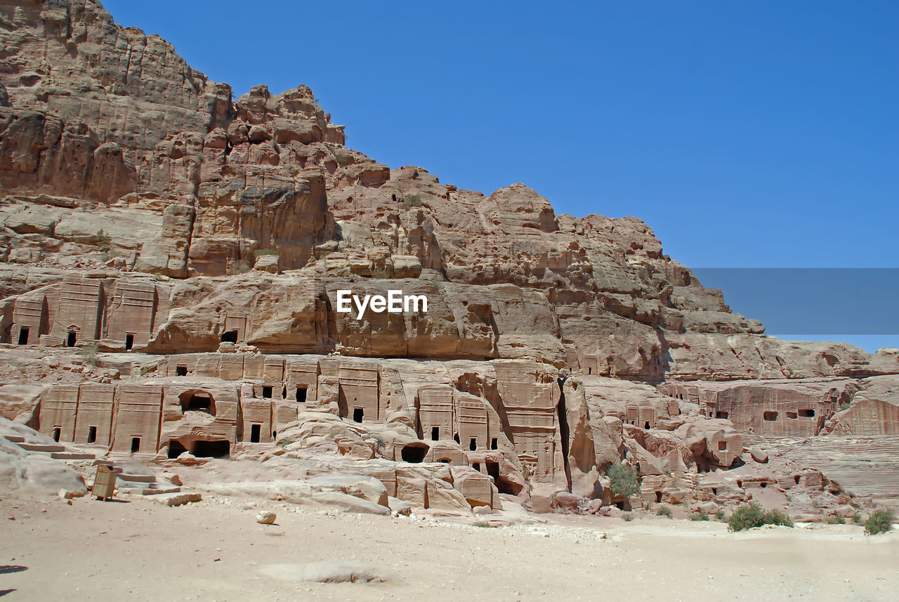 history, the past, ancient, sky, clear sky, architecture, built structure, travel destinations, old ruin, travel, ancient civilization, no people, nature, rock, rock formation, day, tourism, solid, blue, low angle view, climate, arid climate, outdoors, archaeology, ruined