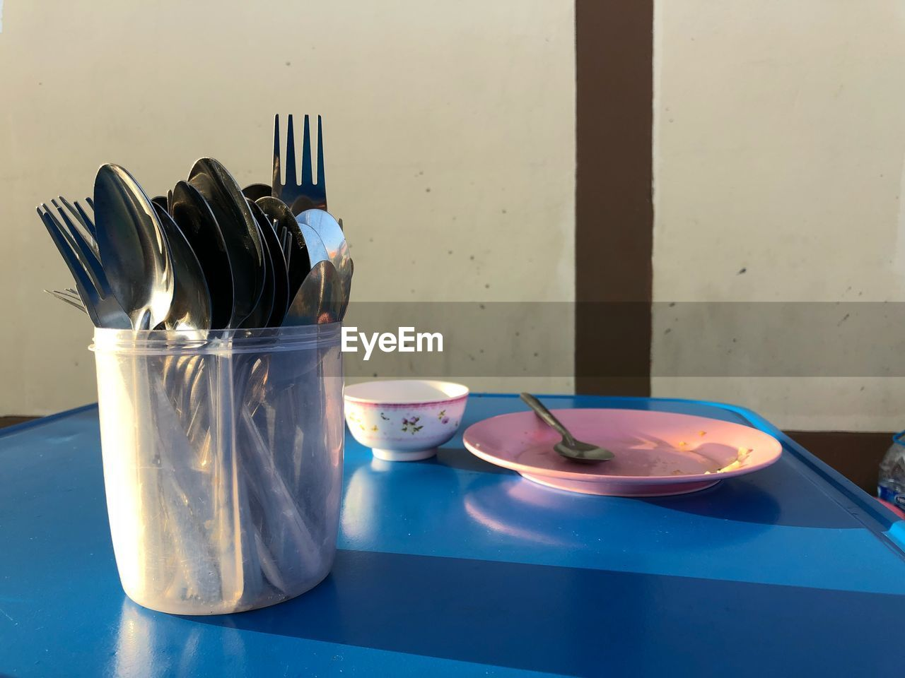 kitchen utensil, table, eating utensil, food and drink, indoors, household equipment, food, no people, still life, fork, container, spoon, bowl, plate, domestic room, blue, kitchen, close-up, domestic kitchen, wellbeing, tray, table knife, glass, breakfast