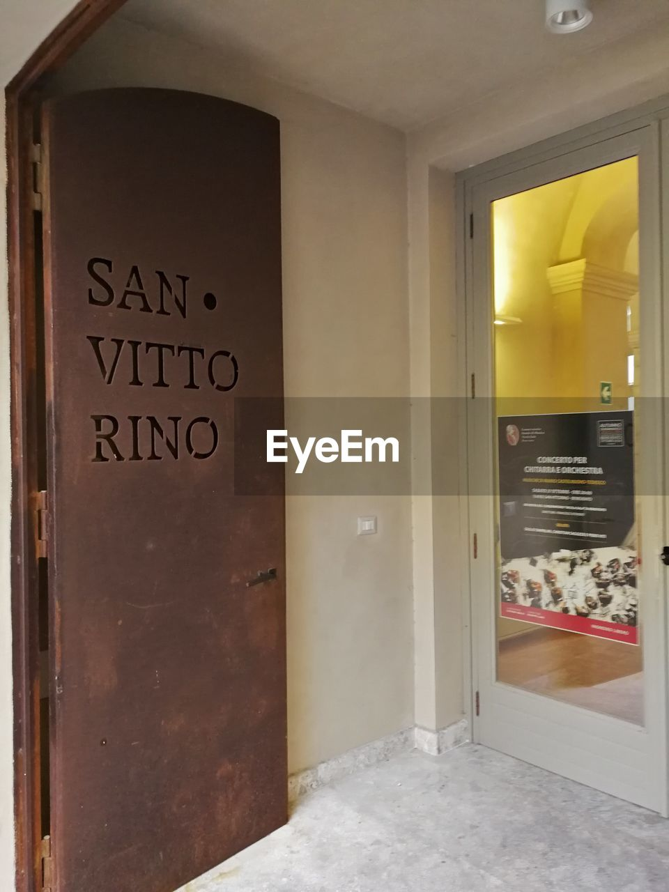 text, western script, communication, no people, indoors, entrance, door, architecture, sign, domestic room, information, home, building, direction, built structure, day, home interior, modern, wood - material, bathroom, message, luxury