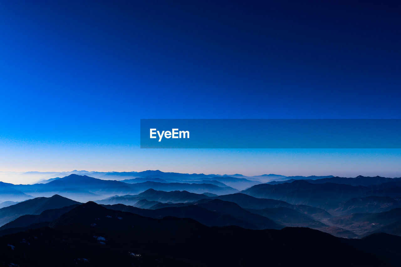 mountain, sky, scenics - nature, beauty in nature, mountain range, tranquil scene, blue, tranquility, copy space, nature, no people, non-urban scene, idyllic, landscape, silhouette, environment, clear sky, remote, day, outdoors, mountain peak