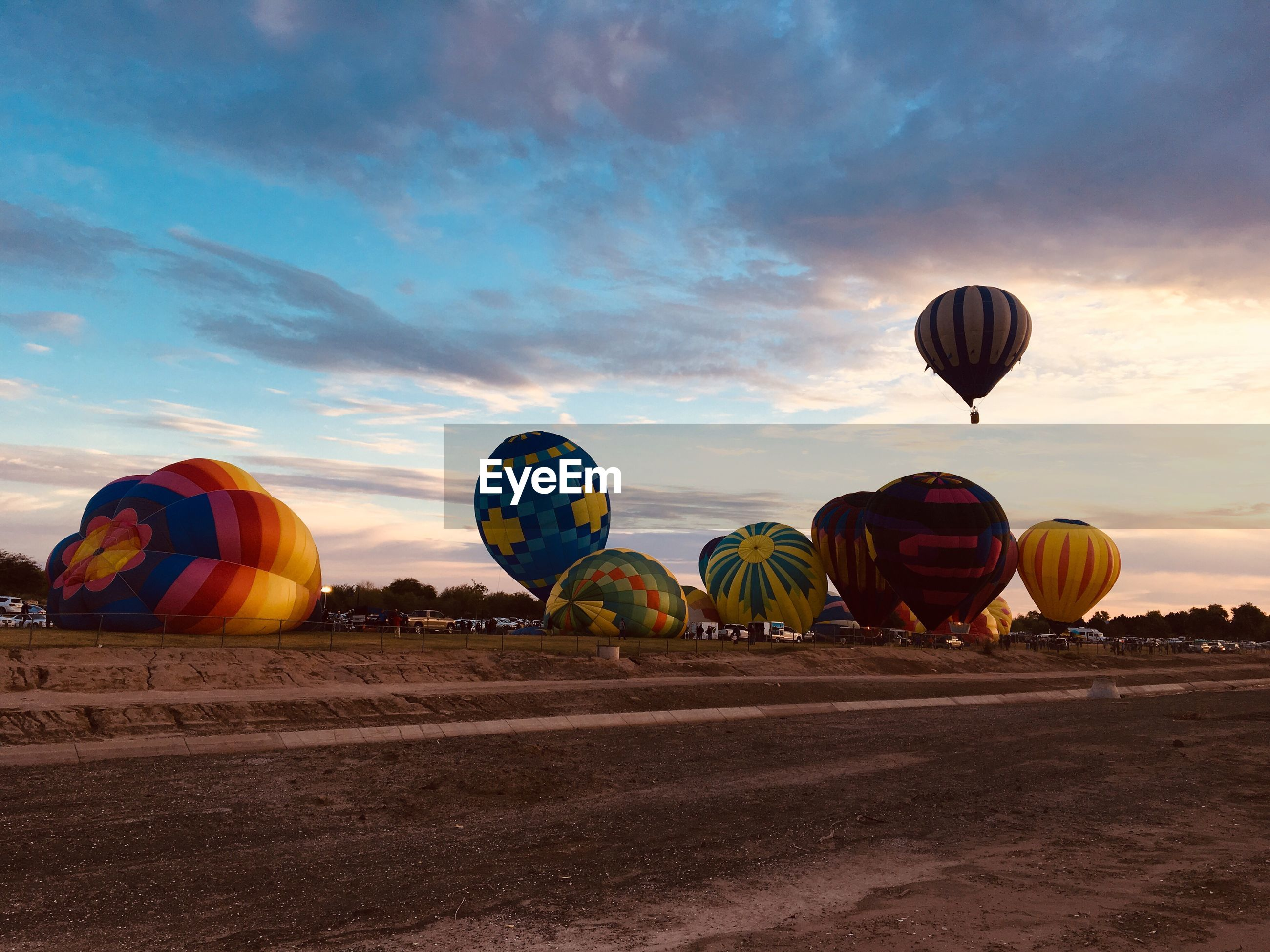 sky, balloon, transportation, hot air balloon, cloud - sky, air vehicle, nature, multi colored, land, mode of transportation, adventure, outdoors, field, celebration, beauty in nature, no people, ballooning festival, day, scenics - nature, orange color
