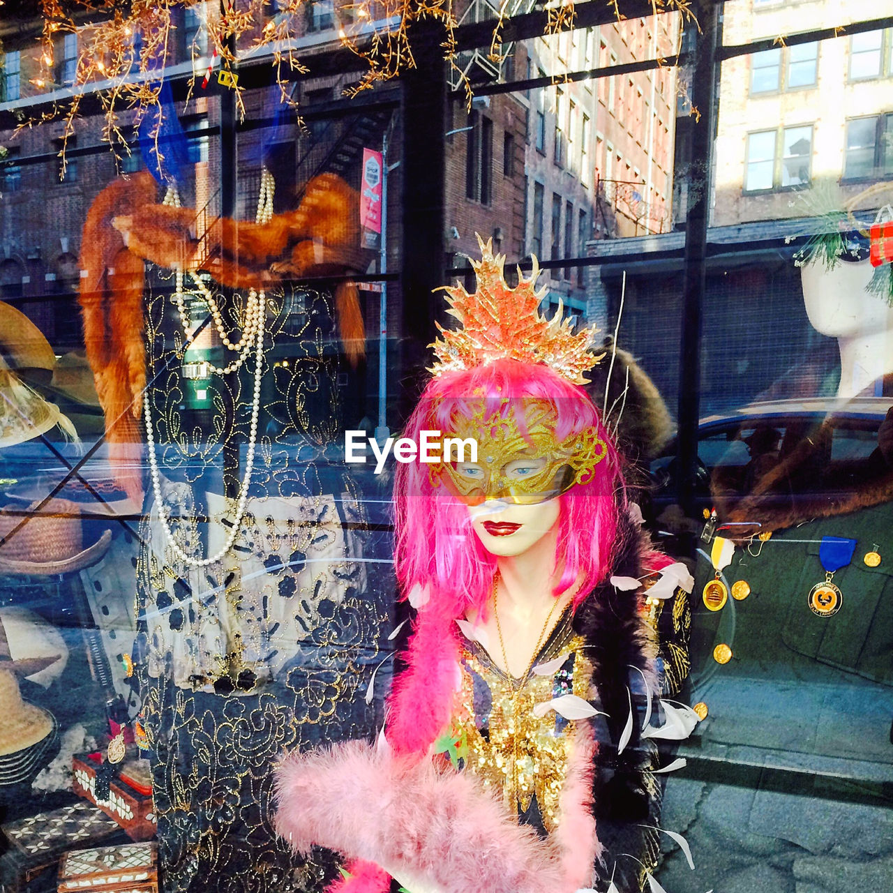 real people, retail, carnival, lifestyles, venetian mask, day, architecture, one person, outdoors, building exterior, women, people