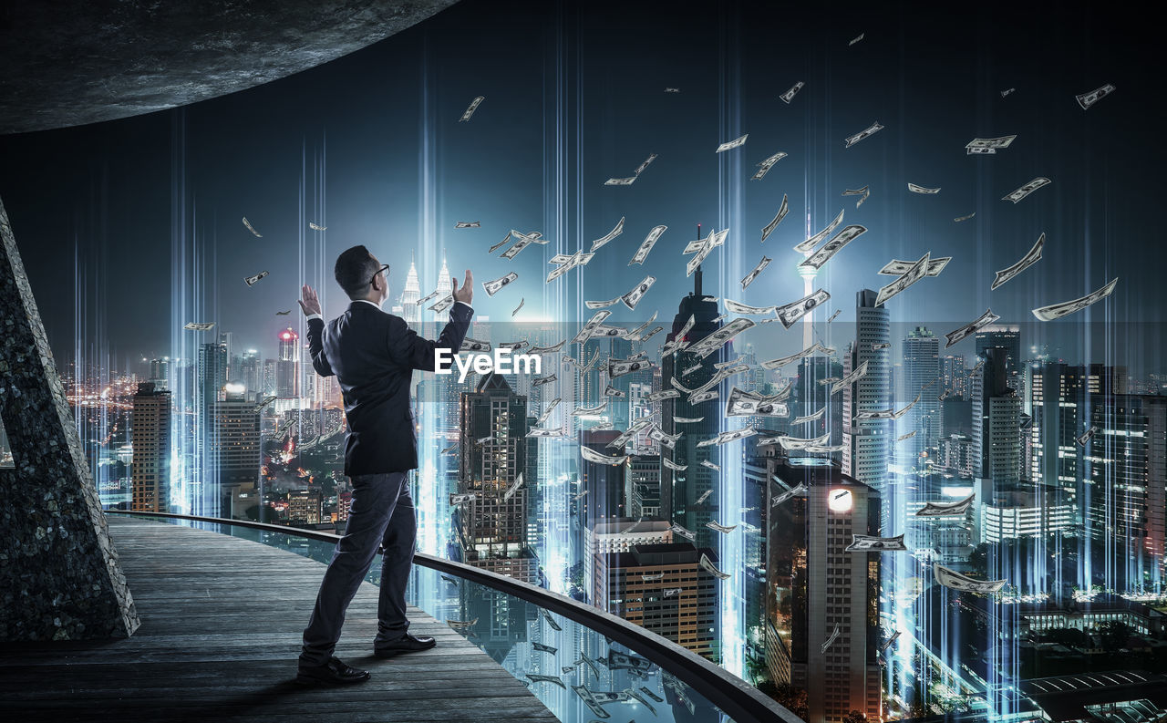 Digital Composite Image Of Businessman With Currency In Mid-Air