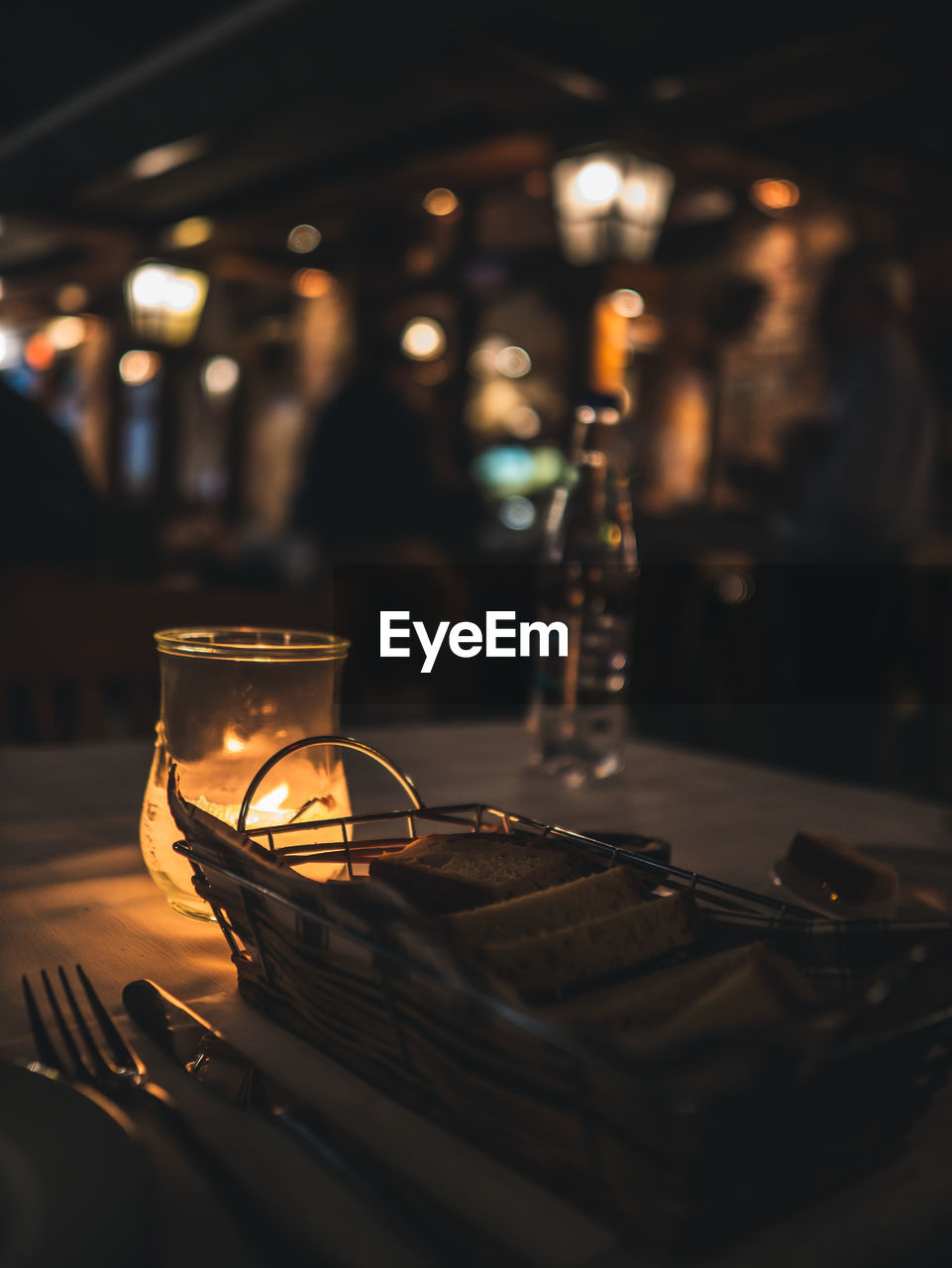 food and drink, drink, refreshment, illuminated, indoors, table, still life, restaurant, glass, business, no people, household equipment, lighting equipment, selective focus, drinking glass, focus on foreground, glass - material, night, freshness, kitchen utensil, setting, light, crockery