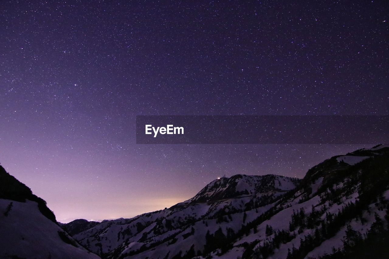 Star Field Over Snow Covered Mountains At Night