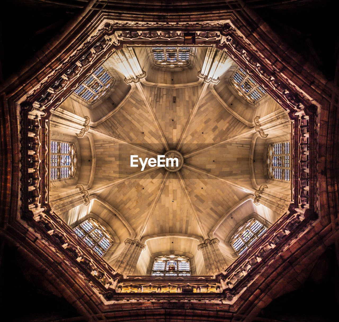 architecture, ceiling, indoors, belief, built structure, religion, place of worship, spirituality, low angle view, directly below, no people, building, travel destinations, pattern, design, ornate, geometric shape, architecture and art, glass, cupola, gothic style, architectural column