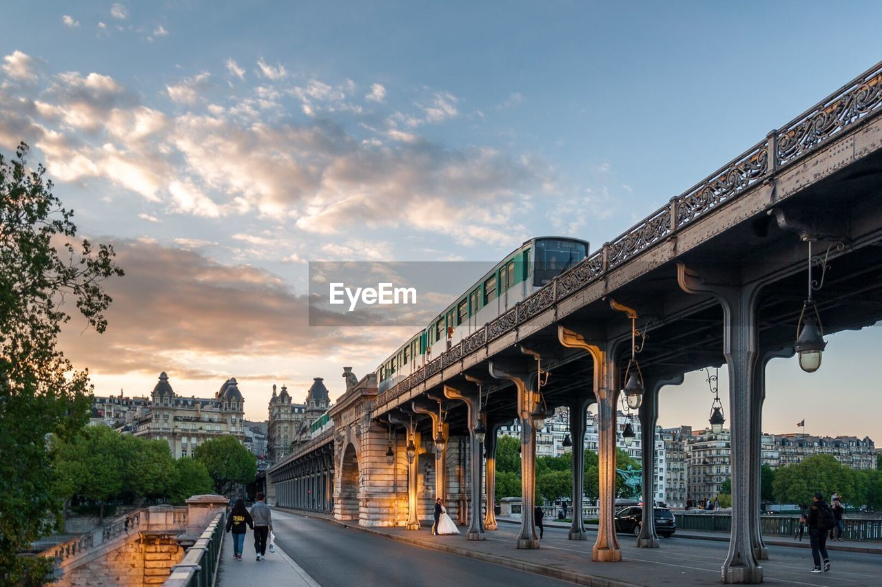 bridge - man made structure, architecture, transportation, connection, built structure, sky, cloud - sky, road, outdoors, the way forward, day, city, tree, building exterior, no people, nature