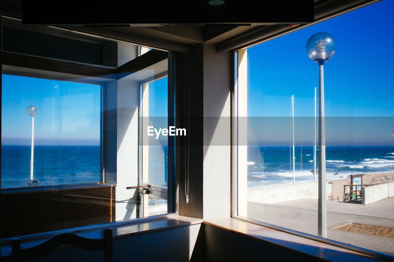 Sea Seen Through Glass Windows In Restaurant