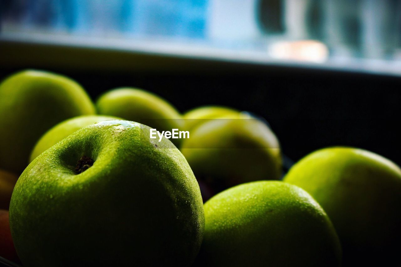 Close-Up Of Granny Smith Apples On Table
