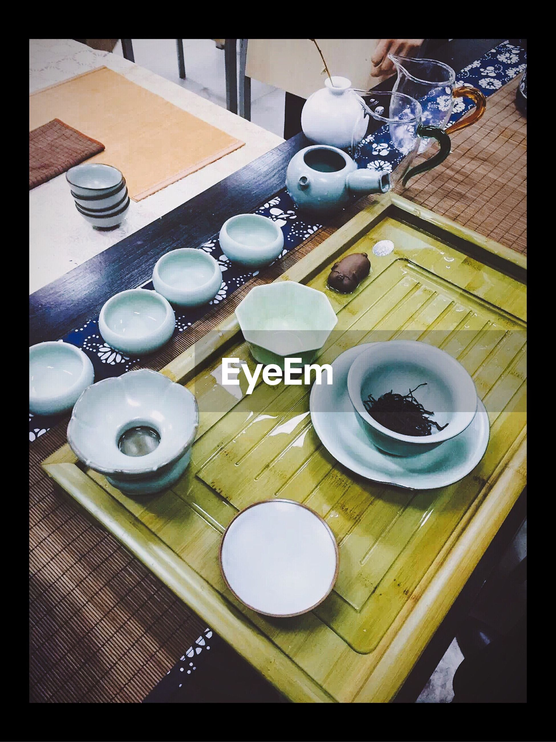 indoors, transfer print, table, coffee cup, food and drink, drink, high angle view, auto post production filter, still life, coffee - drink, refreshment, cup, plate, saucer, spoon, coffee, directly above, wood - material, breakfast, tea cup