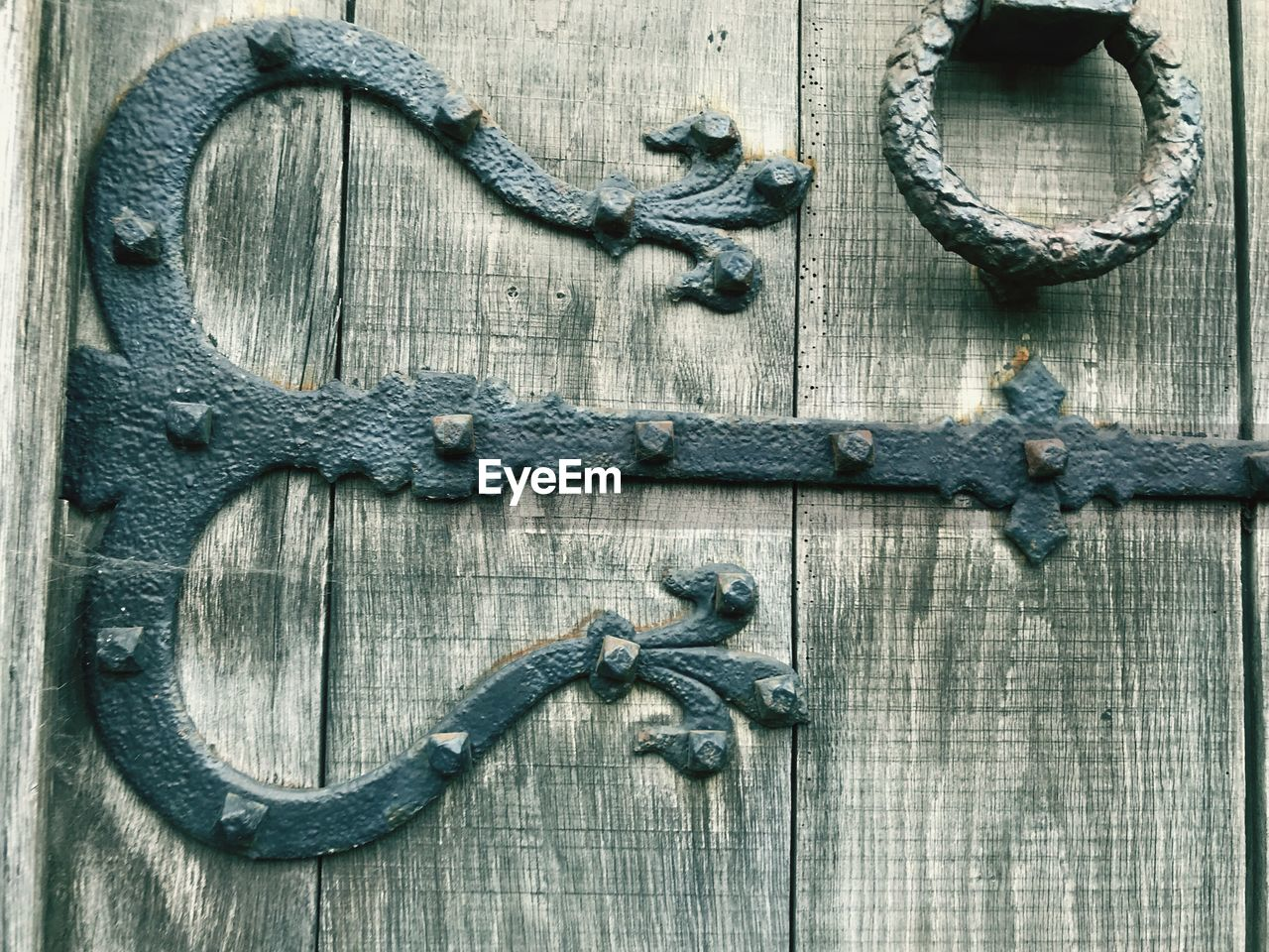 wood - material, metal, old, antique, close-up, textured, no people, indoors, door, door knocker, backgrounds, protection, security, entrance, wood, table, rusty, day, black color, wood grain, ornate