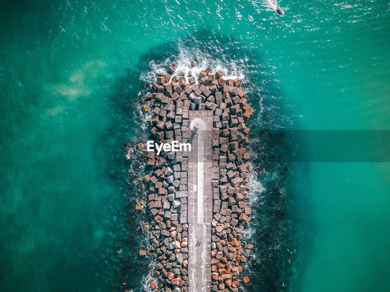High Angle View Of Stones In Sea