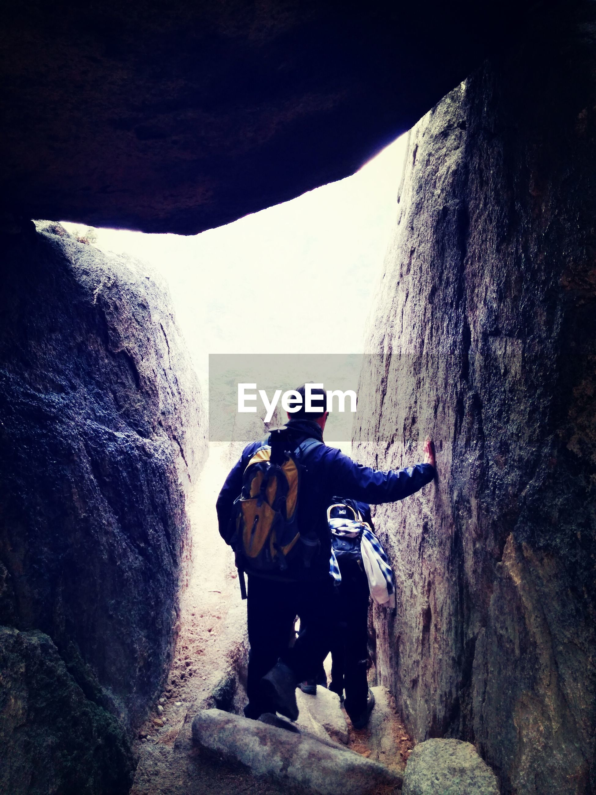 men, lifestyles, leisure activity, rock - object, mountain, adventure, full length, rear view, rock formation, hiking, exploration, backpack, nature, travel, tourist, standing, rocky mountains