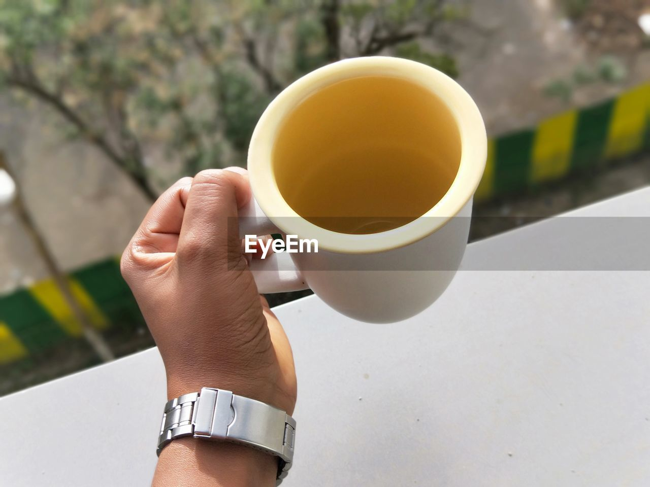 cup, mug, hand, refreshment, human hand, one person, drink, human body part, food and drink, lifestyles, real people, coffee, coffee cup, coffee - drink, holding, body part, tea, day, hot drink, tea - hot drink, finger, tea cup, non-alcoholic beverage, human limb