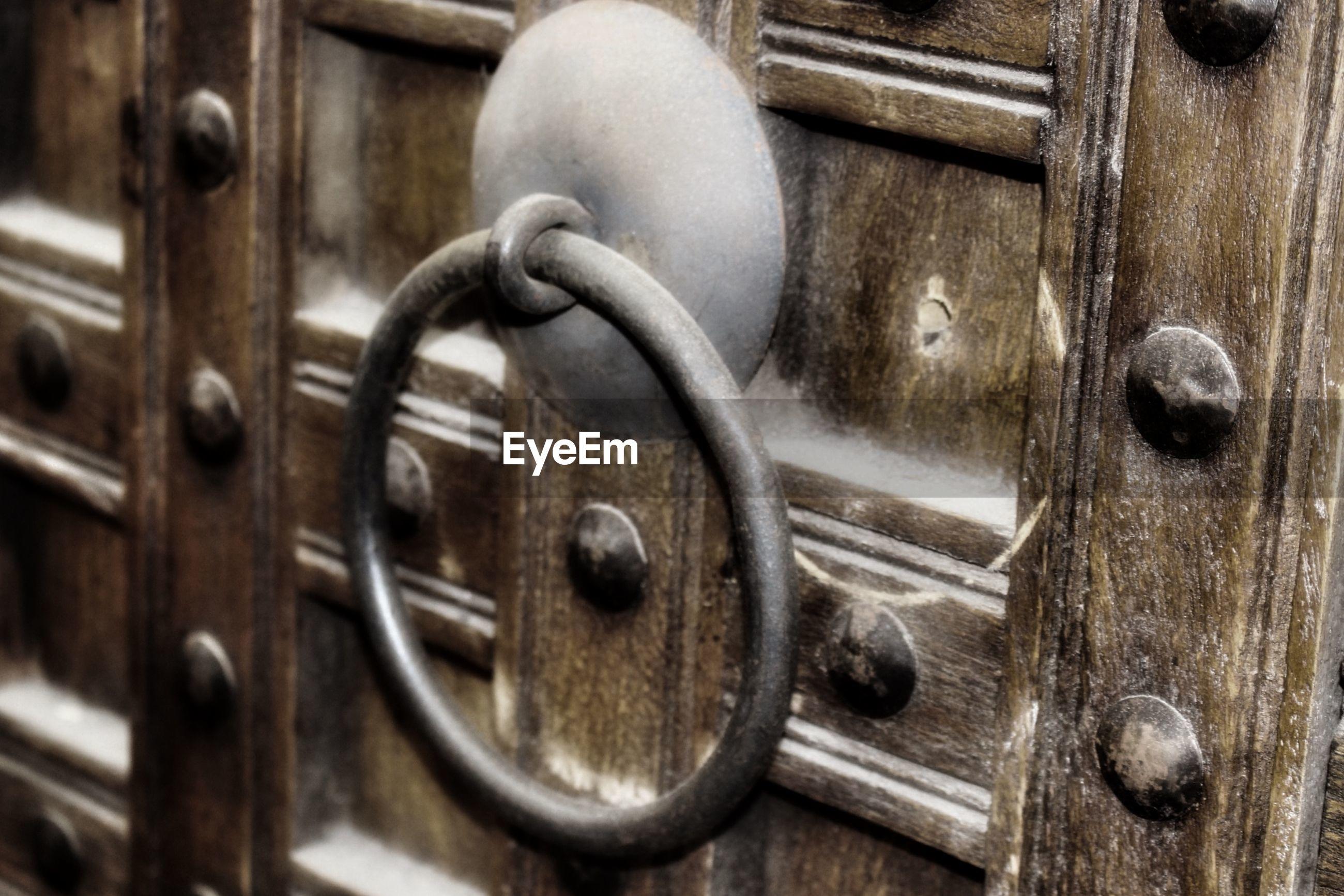 Close-up of door knock on wooden door