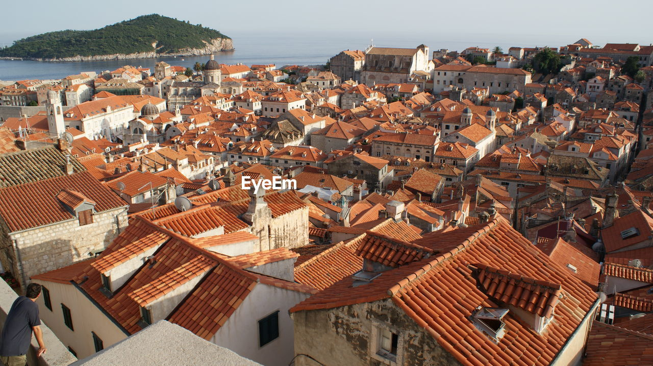 High Angle View Of Houses In Town Against Sky