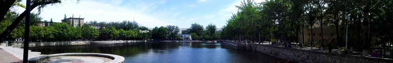 water, architecture, tree, built structure, building exterior, sky, day, river, outdoors, no people, nature, panoramic