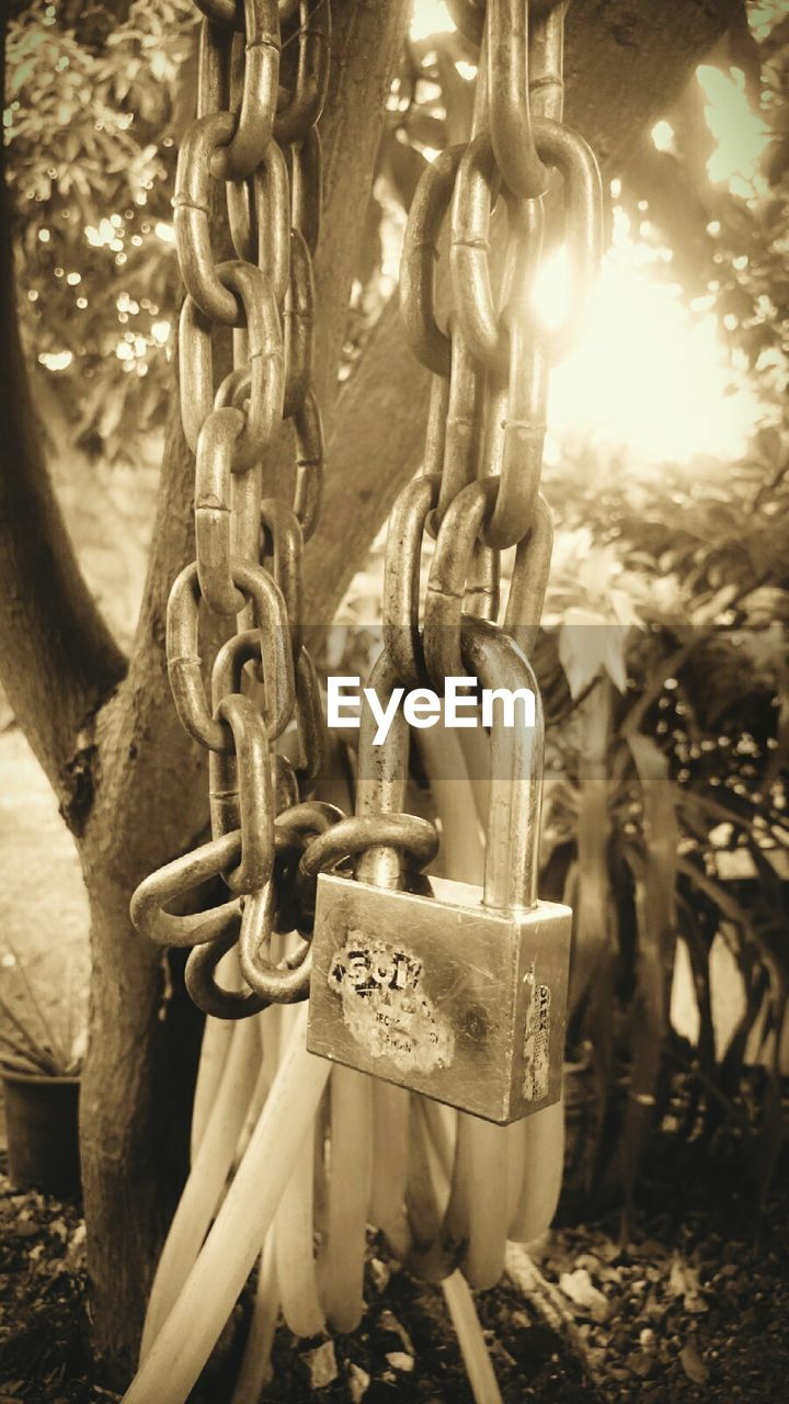 security, metal, chain, outdoors, close-up, no people, day, focus on foreground, hanging