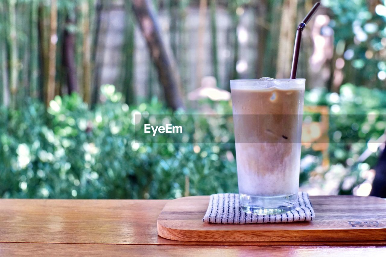 Close-up of coffee on wooden table
