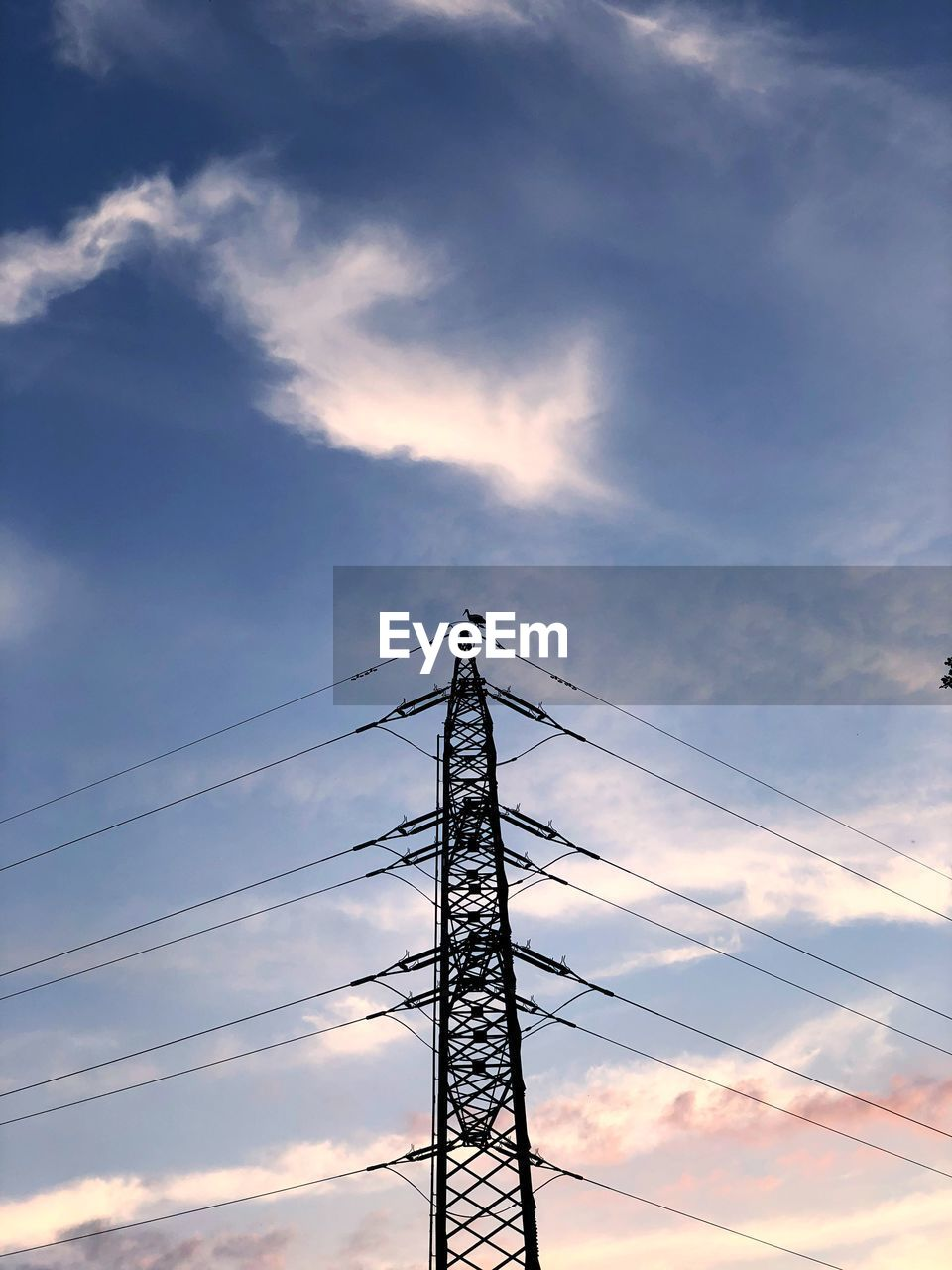cloud - sky, sky, low angle view, technology, electricity, connection, electricity pylon, cable, power supply, power line, nature, metal, architecture, no people, built structure, fuel and power generation, silhouette, outdoors, sunset, tall - high, global communications, electrical equipment