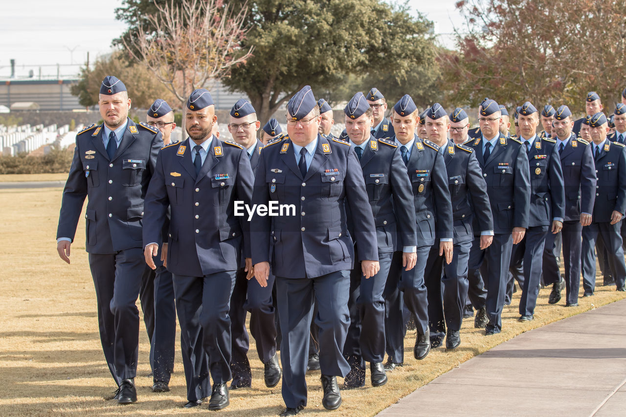 group of people, full length, men, large group of people, crowd, day, clothing, government, real people, in a row, well-dressed, uniform, adult, occupation, front view, togetherness, outdoors, responsibility, coworker