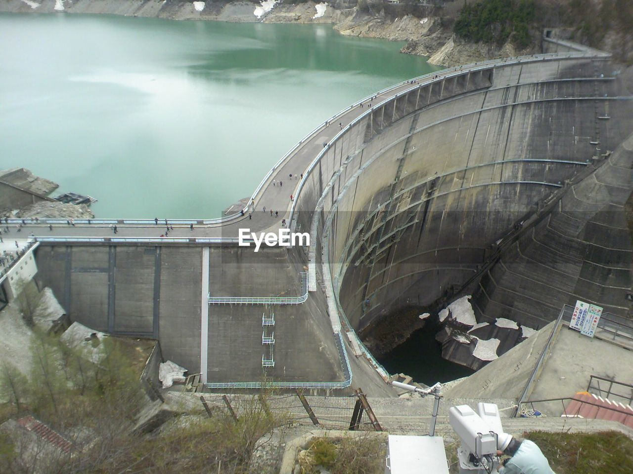 water, architecture, dam, day, nature, built structure, high angle view, no people, hydroelectric power, reservoir, lake, plant, outdoors, building exterior, transportation, tree, travel, reflection, travel destinations