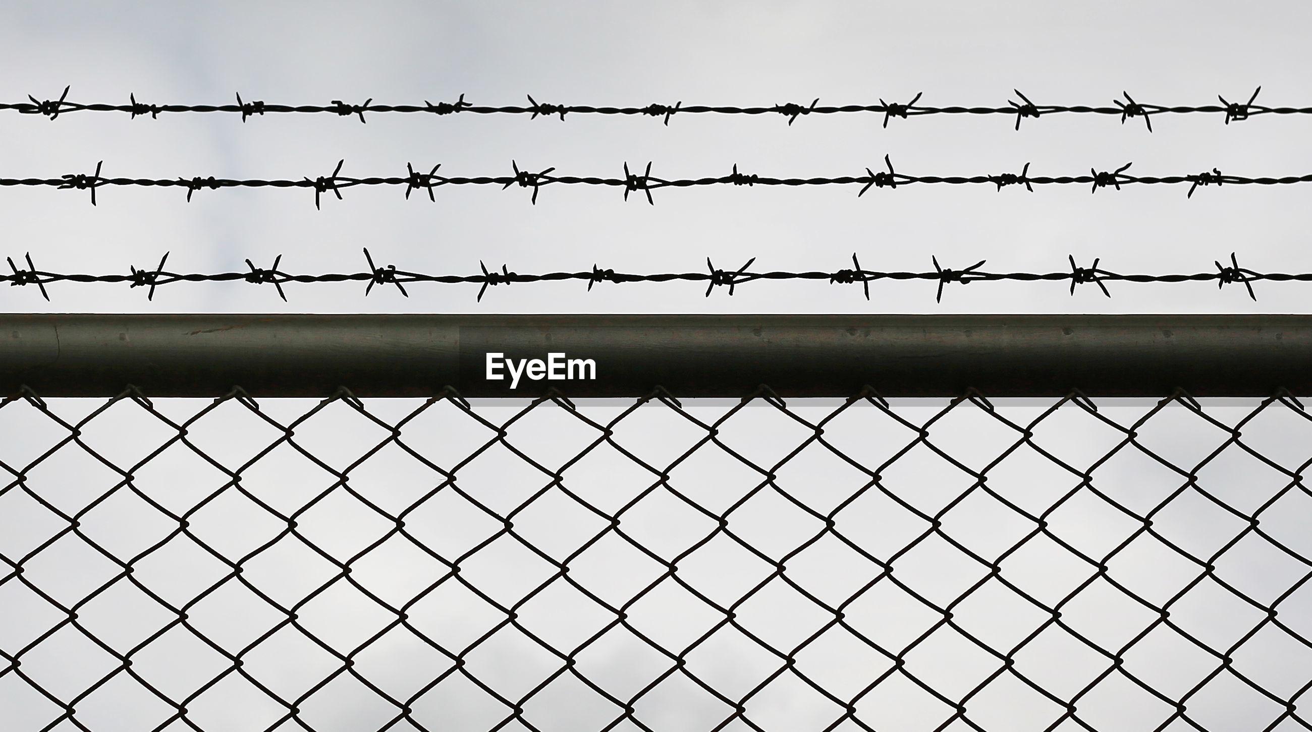 Fence against clear sky