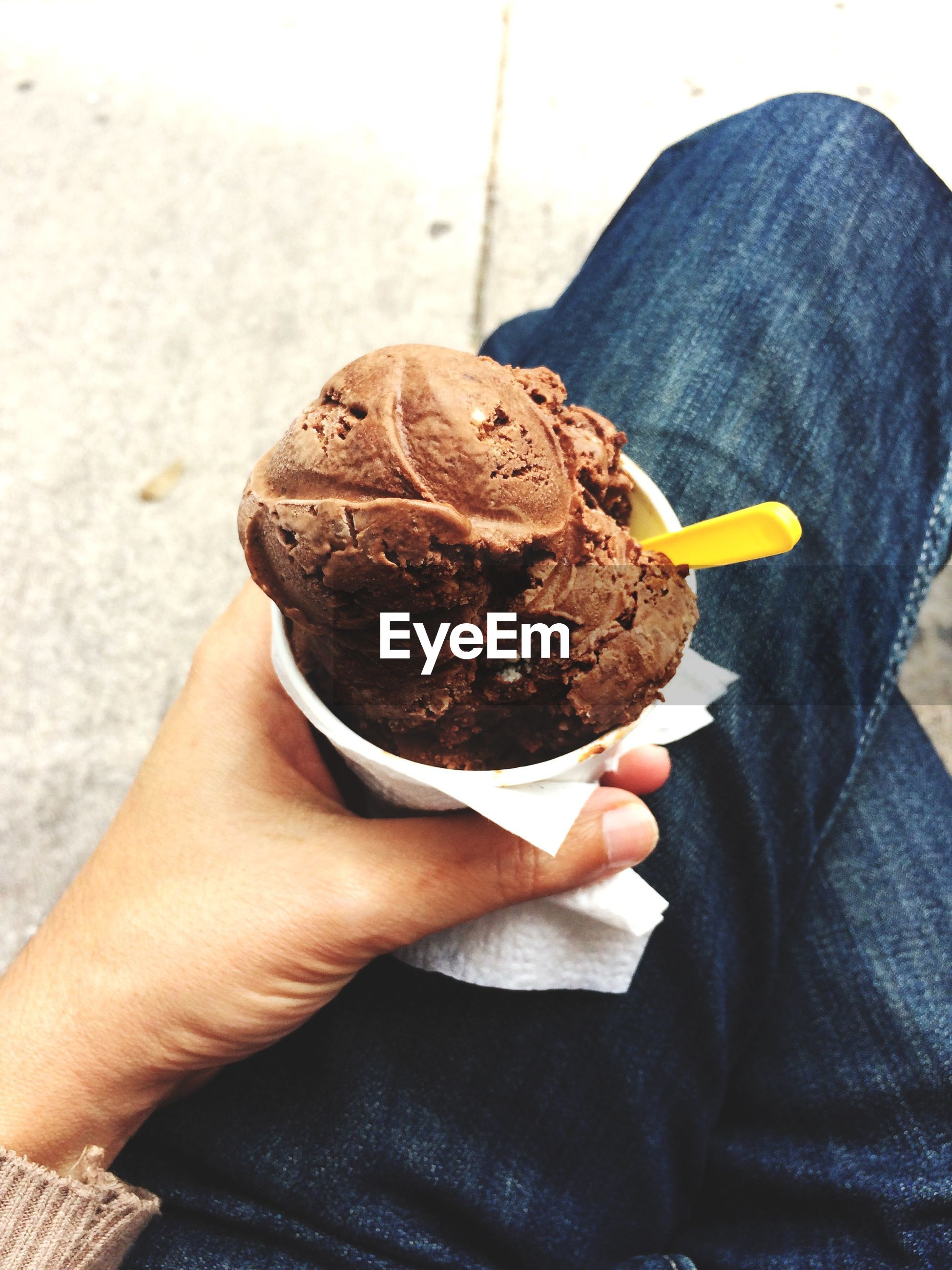 Midsection of person holding ice cream